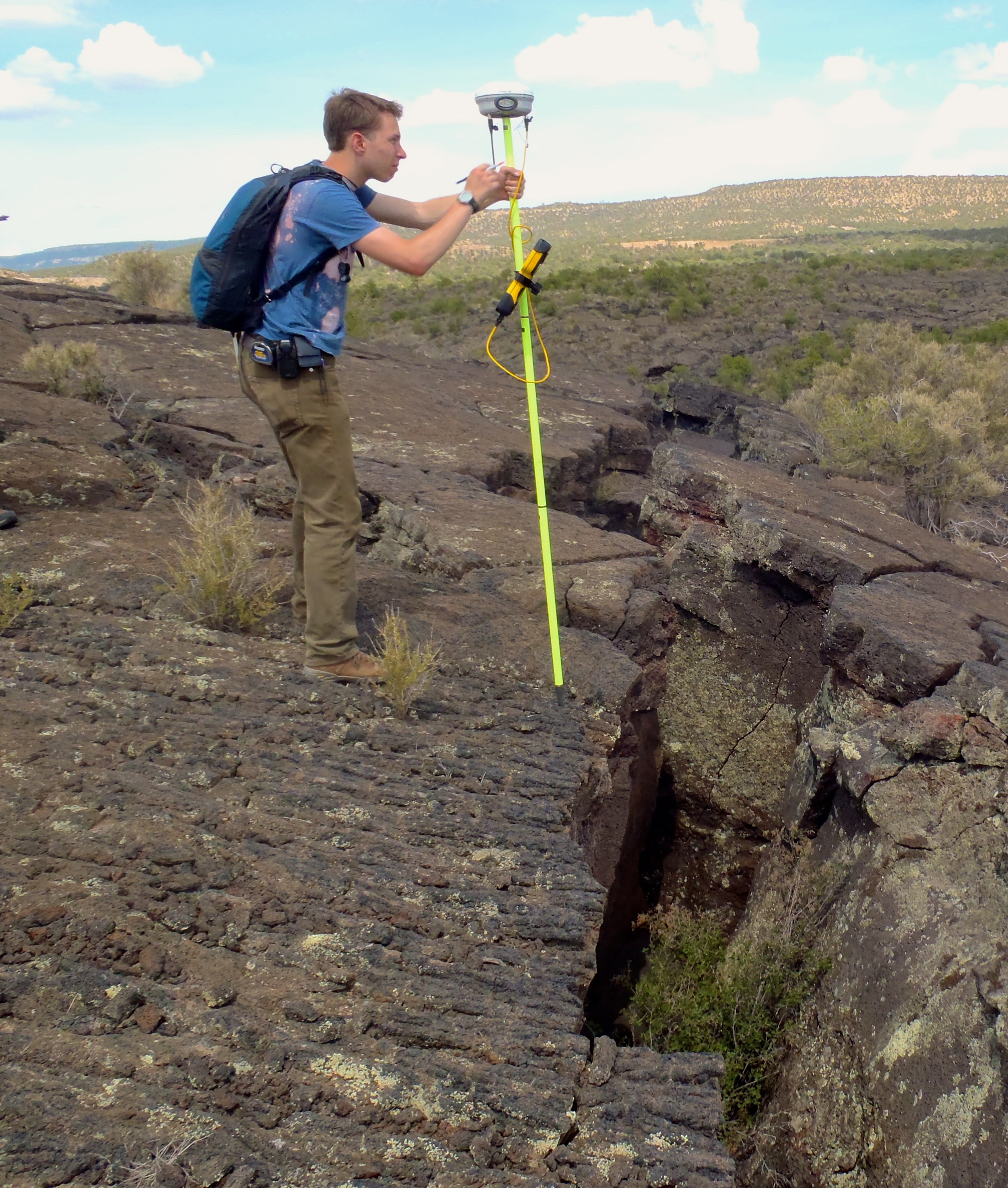 Using a differential GPS rover unit in El Malpais National Monument, New Mexico